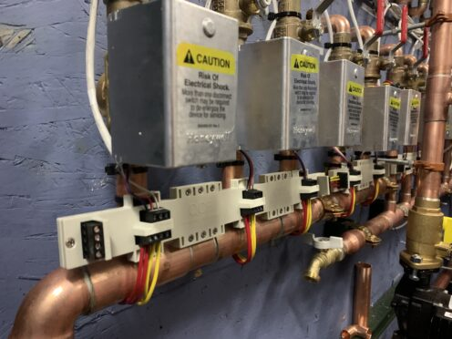 Side angle of QCB valve control device connected to heating area.